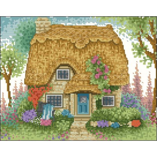 Къща с цветни лехи